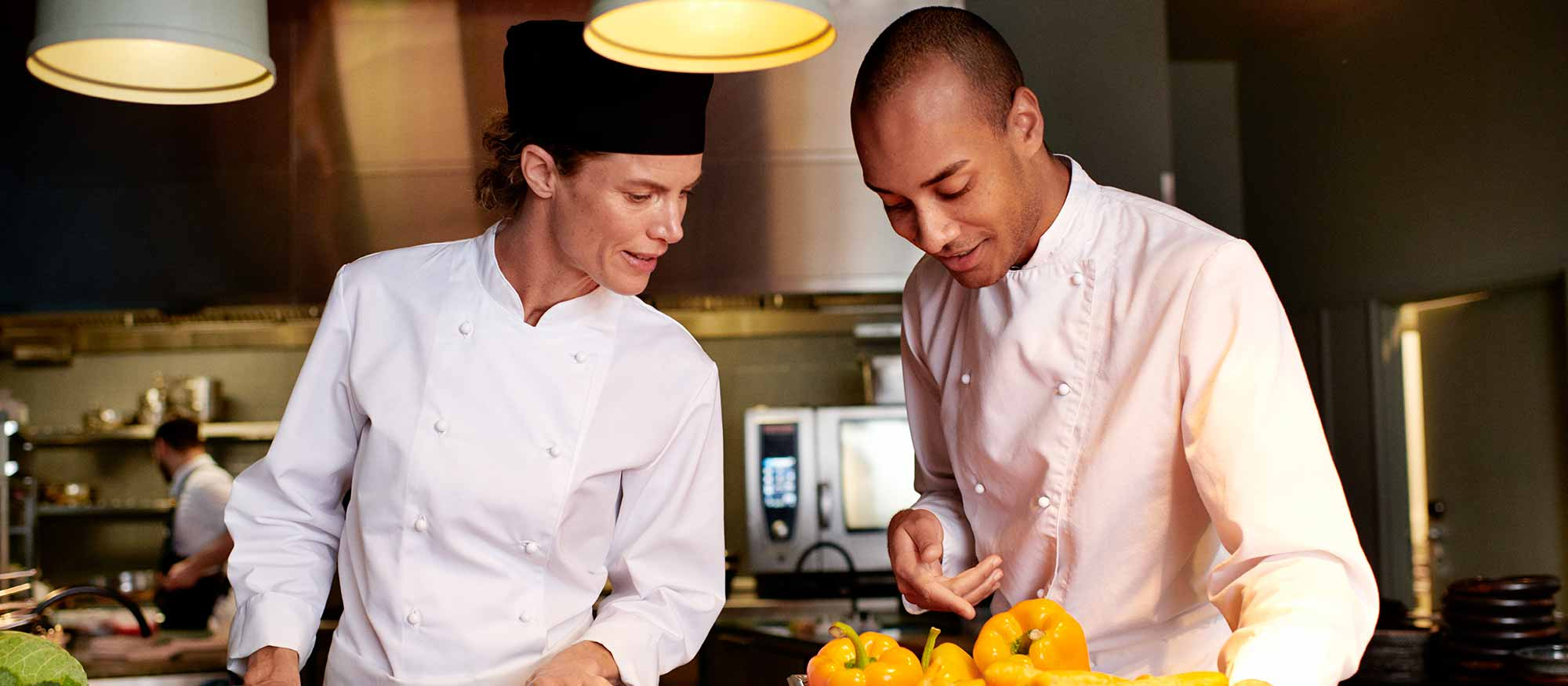 Two chefs in a restaurant kitchen